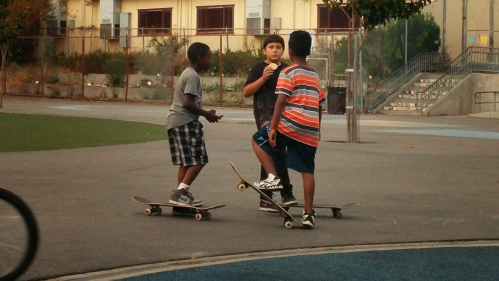 Skater kids enjoy Bella Vista park early in the evening.