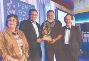 from left: TCE Board Member Jane Garcia, TCE Senior Vice President Dr. Tony Iton, Honoree  Arnold Perkins, Dr. Art Chen