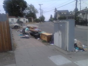 Pile of dumped garbage on E 27th
