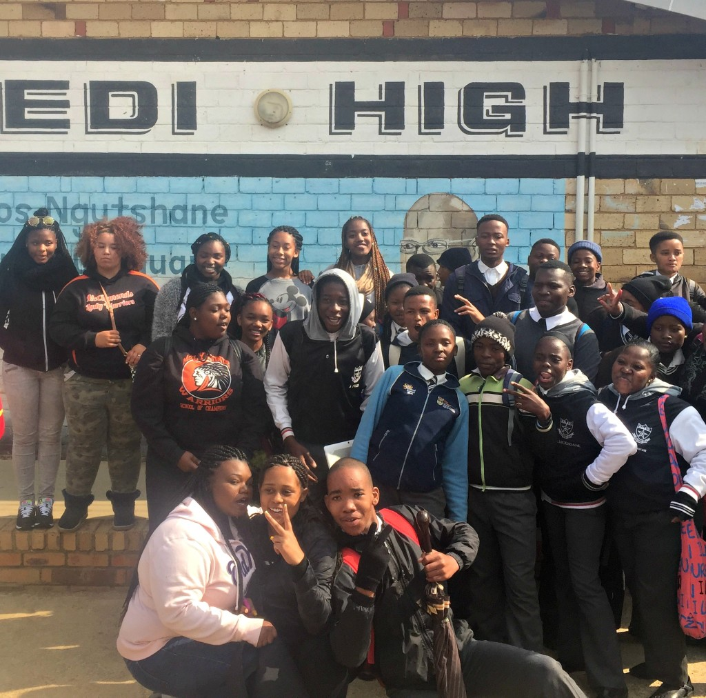 Girls at Naledi HS, with LeAhana Smith, Nakaya Forte and a South African student in the foreground.Photo by Imani Lott.