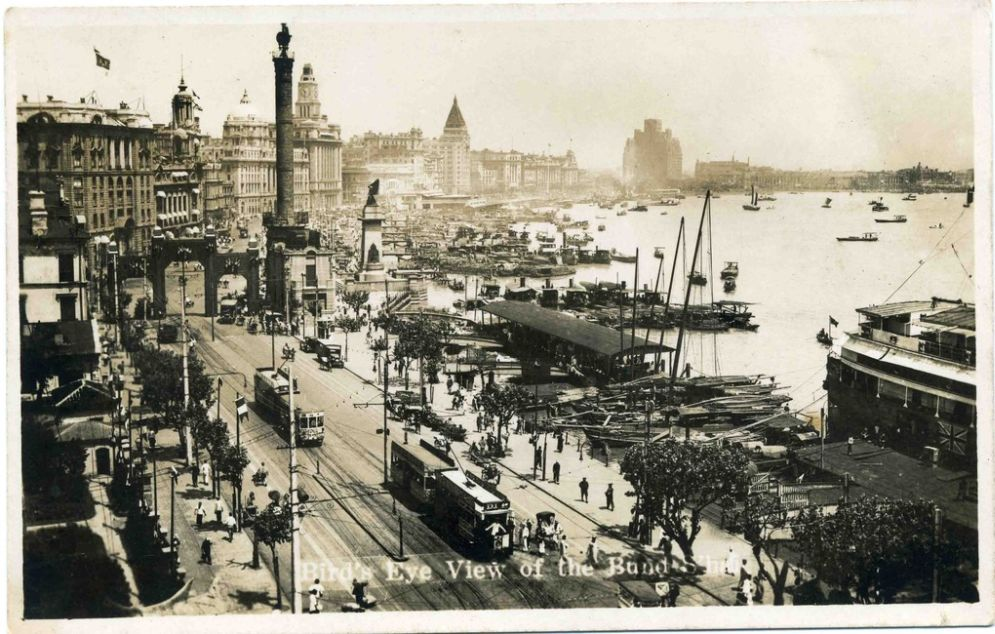 "Vintage postcard reads ""Birds-eye view of The Bund."" Shanghai, China. Circa 1930s. (Public Domain)"