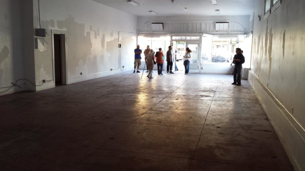 Community members tour the inside of 2701 Fruitvale Avenue in June 2015. Photo Credit: Andrew Park