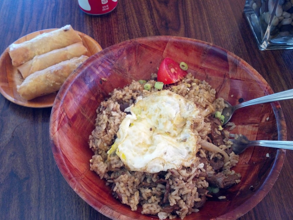 Bistek Fried Rice with fried egg and side of lumpia. Photo: Marj P., Yelp.