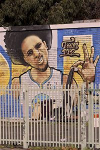 A mural of Steph Curry is one block away from Sean Moses' homeless camp in Oakland.
