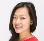 A Chinese American woman smiles at the camera for her headshot.