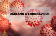 cellular image of novel coronavirus with the word Oakland above