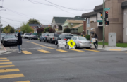 Oakland residents at intersection of 98th Ave and Plymouth Street.
