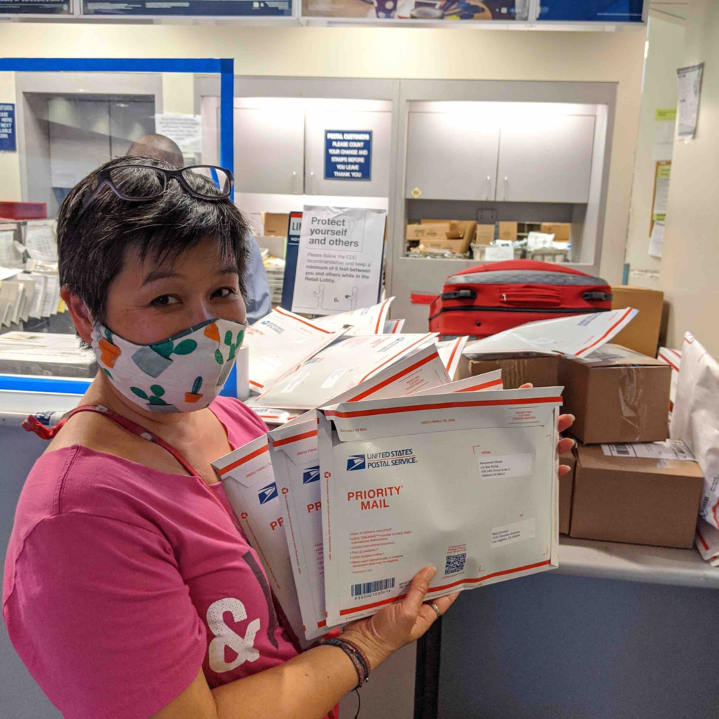 Photo: Kimi Lee dropping off packages for shipping at the USPS