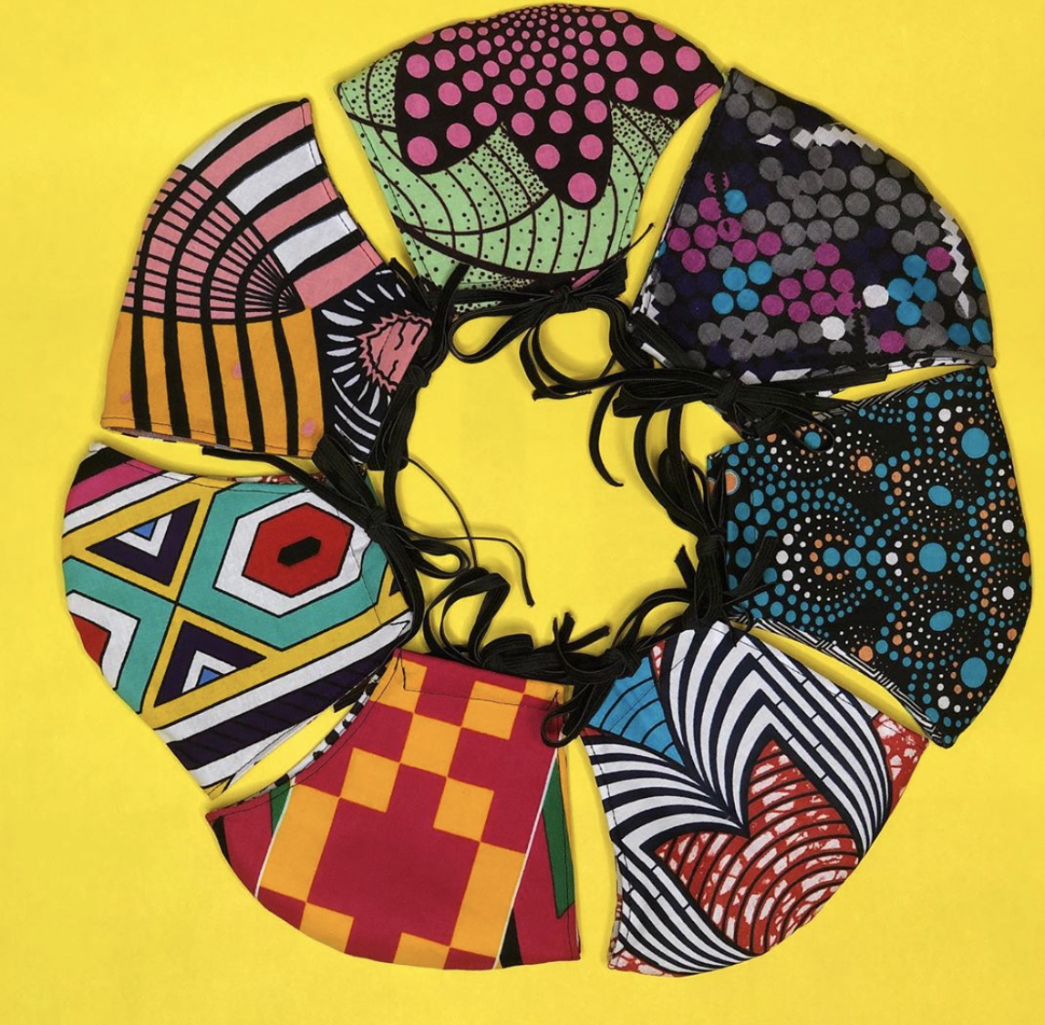 a yellow background with a ring a colorful, printed fabric masks.