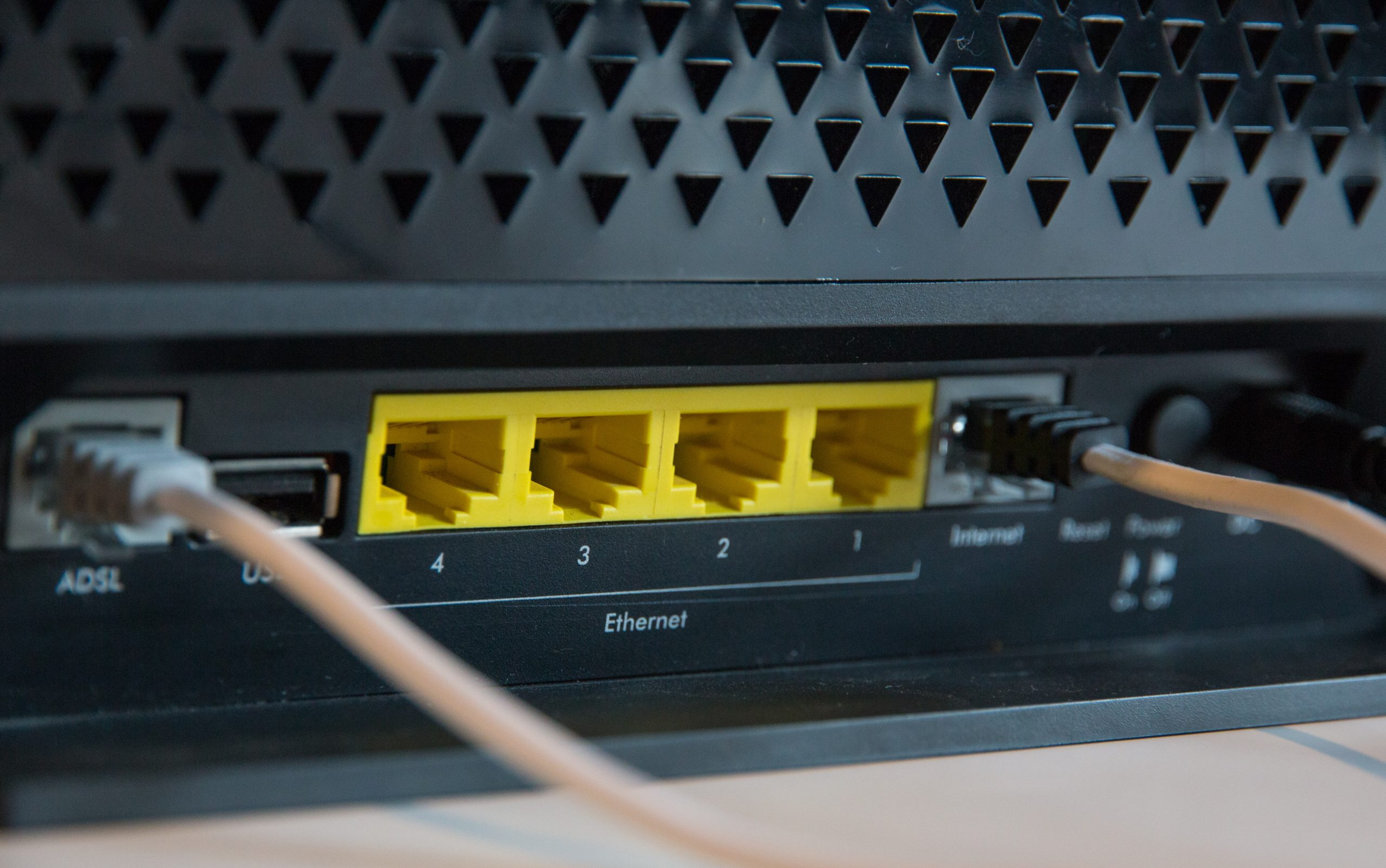A closeup image of a router with two ethernet cords.