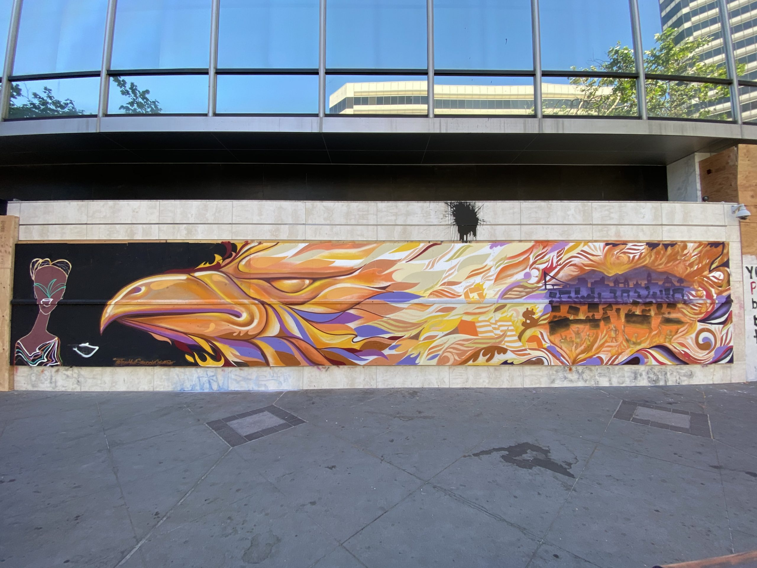 A large mural with an eagle in fire orange colors.