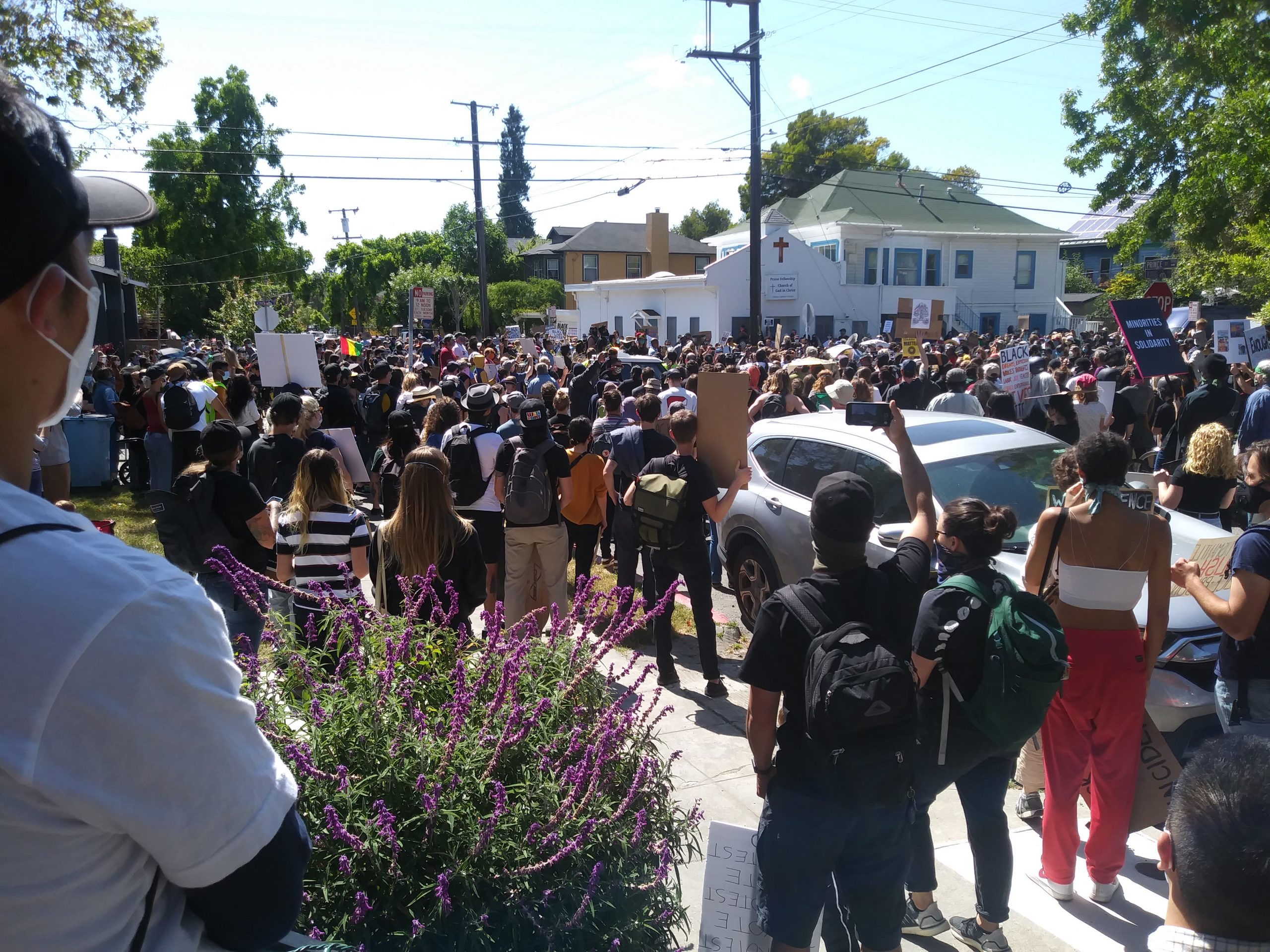 A large crowd with most people wearing masks gather in Berkeley for a Black Lives Matter protest.