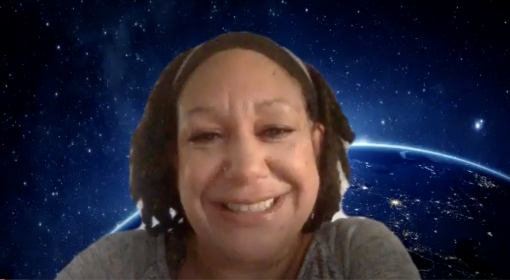 An African American woman is on a Zoom webinar with earth and outer space as the background.