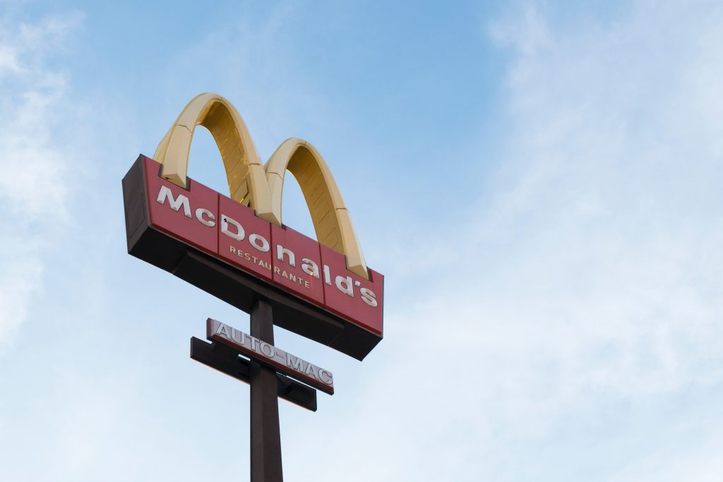 The McDonald's sign against the blue sky.