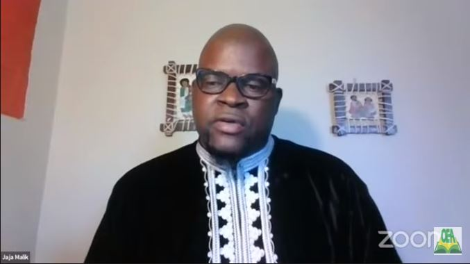 An image of an African American man wearing glasses on a Zoom call.
