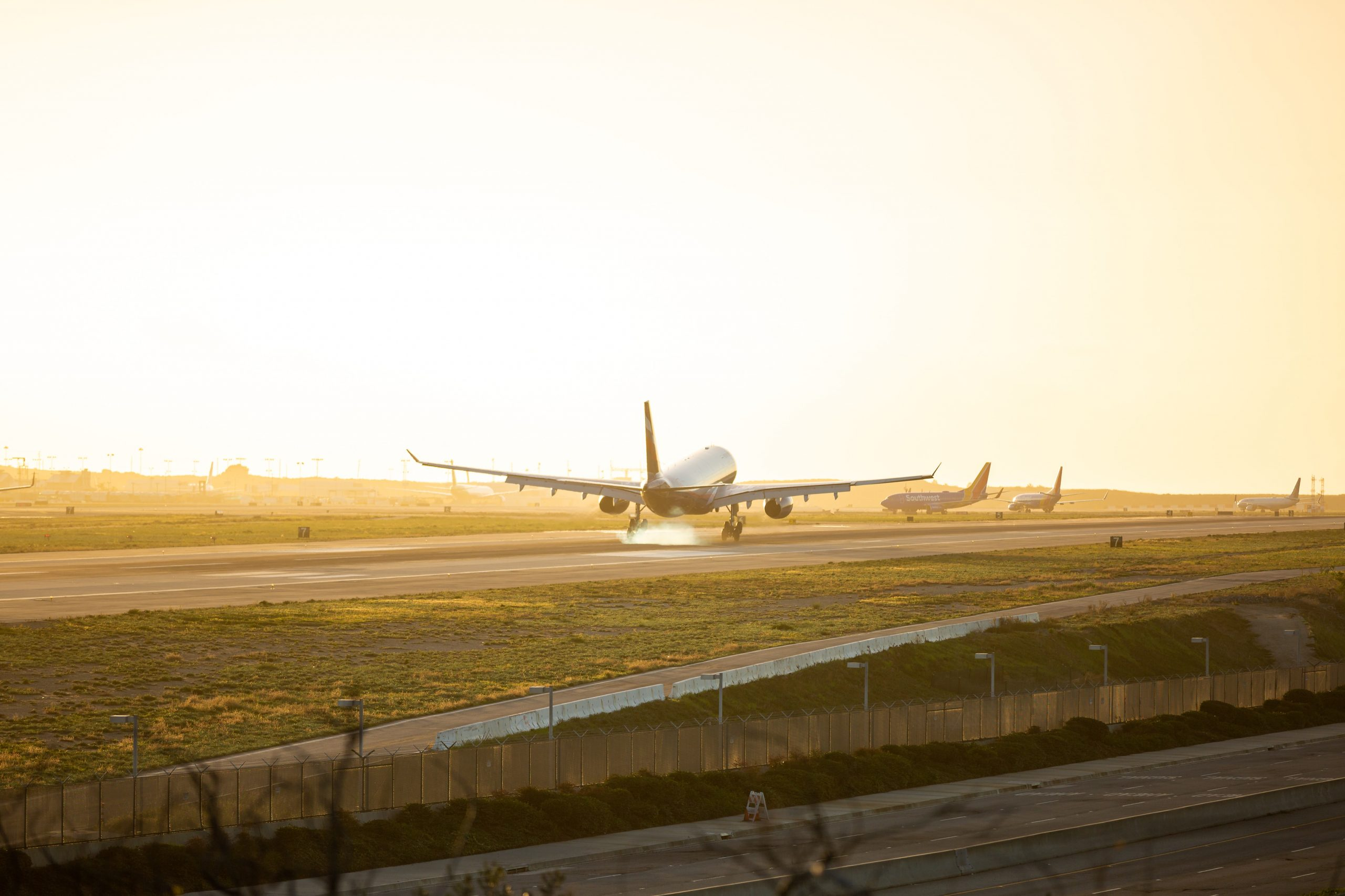 Photo of an airplane waiting to take off on the runway.