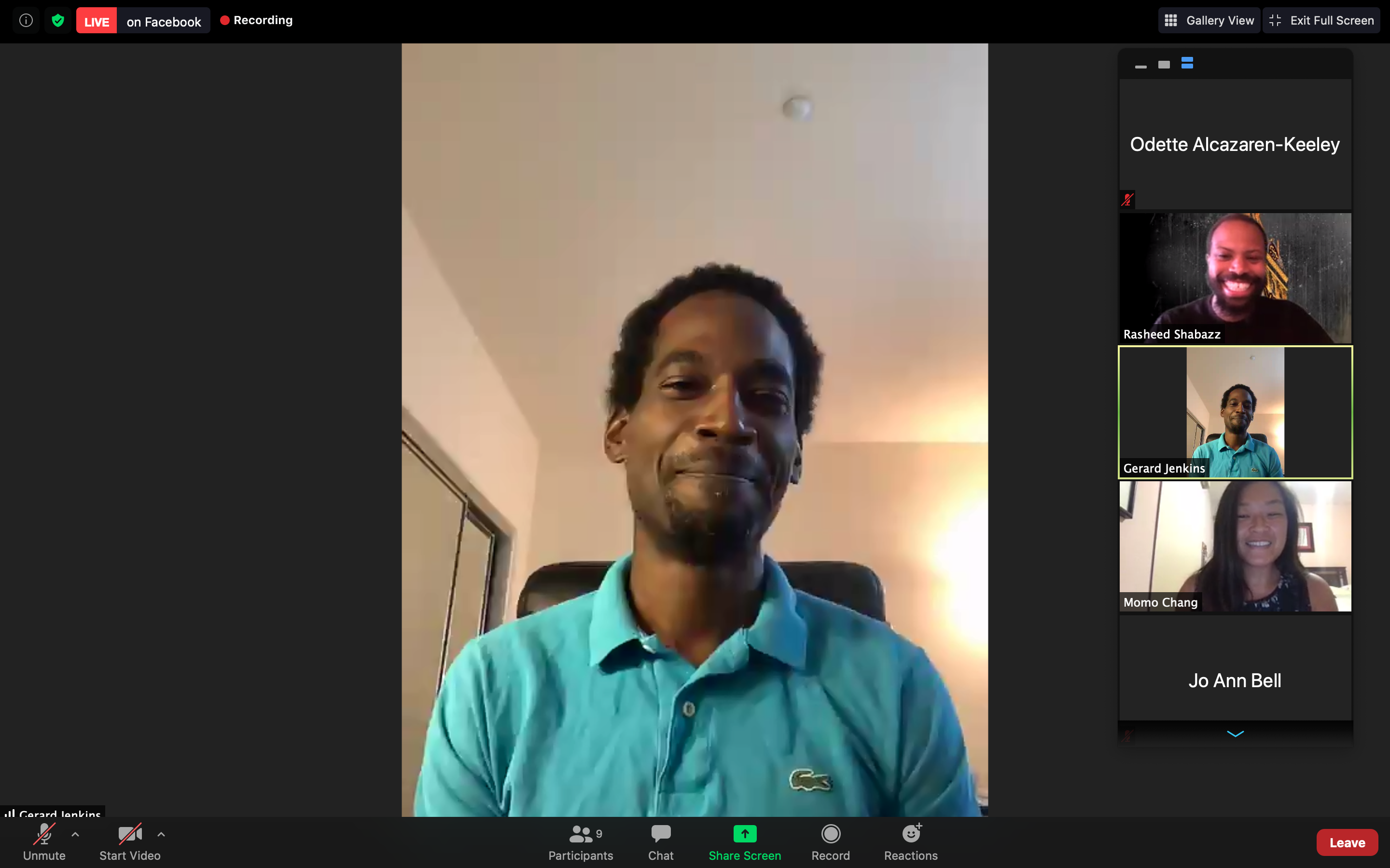 An African American man wearing a turquoise shirt speaks on a Zoom presentation.