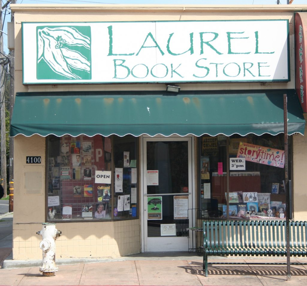 "An image of a small bookstore with ""Laurel Book Store"" on the front."