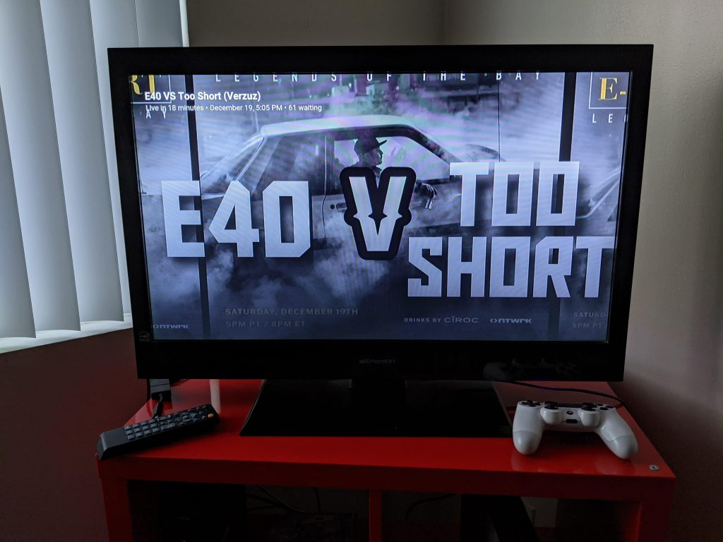 """An image of a large TV with """"E-40 V Too Short"""" on the screen"""