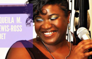 An image pf a smiling African American woman in front of a mic.