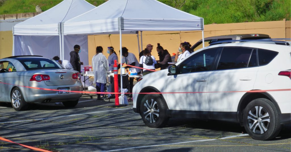 Cars line up to get COVID vaccine in parking lot