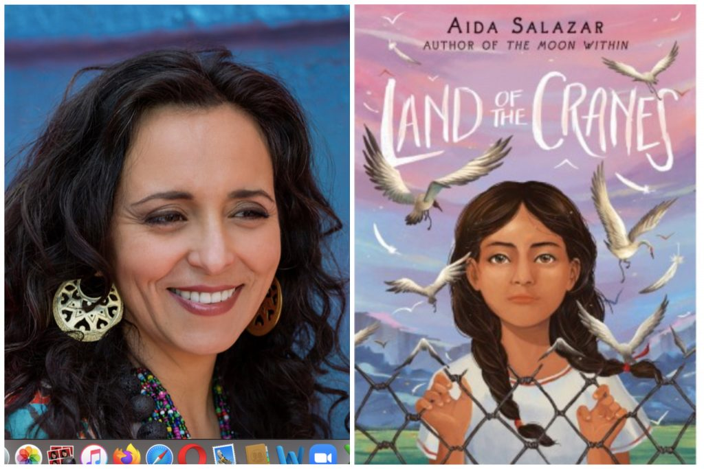 """A Chicana woman with dark brown hair smiles. On the right, an illustrated image of a young brown girl in braids, with a wire fence in front of her and """"Land of the Cranes"""" as the title in white font"""