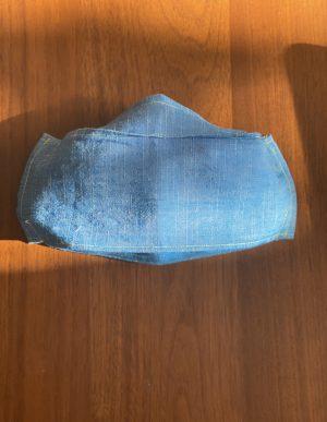 a light demin blue fabric mask
