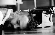 a man puts his head down on the ground in a black and white photo