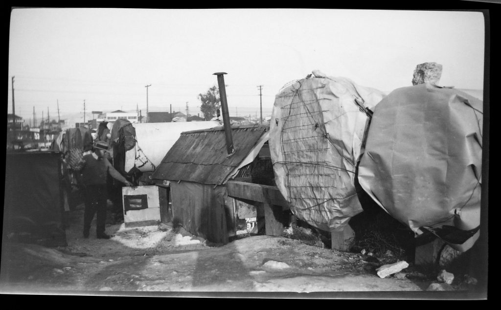 """black and white image of tents set up in the early 1930s in Oakland, dubbed """"Pipe City"""""""