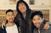 An Asian American mom is in the middle between her two grownup sons