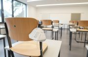 empty classroom and desks with one n95 mask